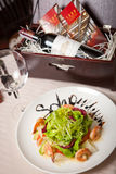 Seafood salad. And red wine in a restaurant Stock Photo