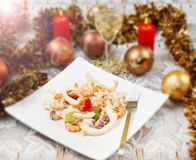 Seafood salad. On christmas table Stock Image