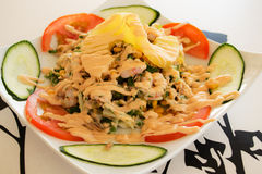 Seafood salad. Seafood salad with a slice of pineapple decorated royalty free stock images
