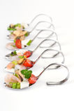 Seafood salad on spoon. Fresh seafood appetizers on spoons Royalty Free Stock Image