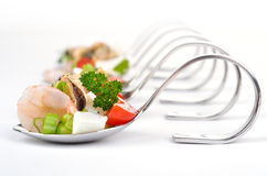 Seafood salad on spoon. Fresh seafood appetizers on spoons Stock Photography