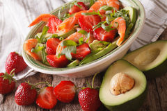 Seafood salad with strawberries and avocado close-up. horizontal. Seafood salad with strawberries and avocado close-up on the table. horizontal royalty free stock photography