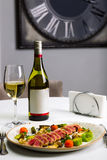 Seafood salad with tuna on white tablecloth background Royalty Free Stock Photo