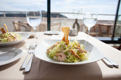 Seafood salad on white plate in restaurant Stock Images