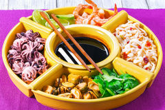 Seafood set of prawns, octopus, mussels, squid rings with lime Royalty Free Stock Image