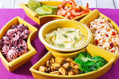 Seafood set of prawns, octopus, mussels, squid rings with lime Stock Photo