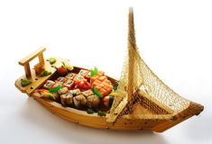 Seafood set on wooden decorative plate Royalty Free Stock Images