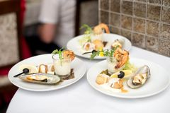 Seafood sets at local restaurant, fine dining, Fresh seafood platter with , mussels and on plate with tartar sauce.  royalty free stock photos