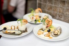 Seafood sets at local restaurant, fine dining, Fresh seafood platter with , mussels and on plate with tartar sauce.  royalty free stock images