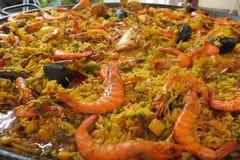 Seafood shellfish paella. Seafood paella with shellfish cooking in a large pan Stock Photo