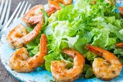 Seafood shrimp lettuce salad on blue plate Stock Photo