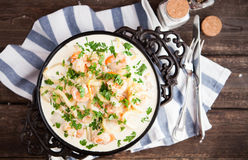 Seafood - shrimp and squid with white cream sauce on frying pa royalty free stock photos