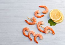 Seafood with shrimps prawns ocean gourmet dinner cooked parsley lemon and skewers shrimp decorate on white wood background. Seafood with shrimps prawns ocean stock images