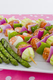 Seafood Skewers are Ready to go on the barbecue. Salmon cubes and Shrimp complimented with vegetables on skewers. Ready to cook. Red onions, zucchini, green Stock Images