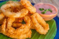 Seafood snacks, calamaris, squid rings in outdoor restaur Royalty Free Stock Photo