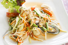 Seafood som tum green papaya salad. Thai food Royalty Free Stock Photo