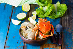 Seafood soup of clams and crabs Paila marina Stock Photos