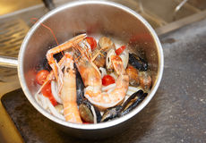 Seafood soup cooking, copy space Royalty Free Stock Image