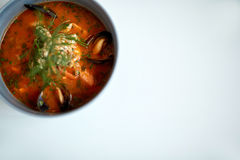 Seafood soup with fish and blue mussels in bowl Stock Photography