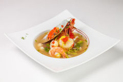 Seafood soup. Isolated on white background Royalty Free Stock Image