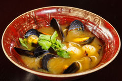 Seafood soup. Of mussels, scallops, squid Stock Photo