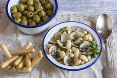Seafood soup with olives and bread sticks Royalty Free Stock Photos