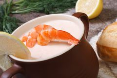 Seafood soup in a pot on a wooden table close up Royalty Free Stock Photo