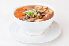 Seafood soup shrimp mussels pasta fish mushrooms in a bowl isolated on white background Royalty Free Stock Photo
