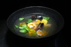 Seafood soup. Tuscan seafood soup with mussels, shrimps and vegetables stock photography