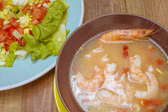 Seafood soup. Vegetable salad with lettuce Royalty Free Stock Image