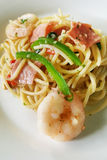 Seafood Spaghetti with ham. Seafood Spaghetti served with shrimps, served with ham and vegetables Stock Image