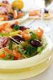 Seafood spaghetti pasta dish with octopus and shrimps Stock Photos