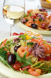 Seafood spaghetti pasta dish with octopus and shrimps Stock Photography