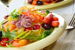 Seafood spaghetti pasta dish with octopus and shrimps Stock Photo