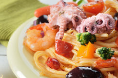 Seafood spaghetti pasta dish with octopus shrimps Stock Photo