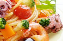 Seafood spaghetti pasta dish with octopus shrimps Stock Image