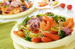 Seafood spaghetti pasta dish with octopus and shrimps Royalty Free Stock Images