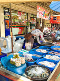 Seafood stall. PHAYAO, THAILAND - JUNE 13 : Unidentified market woman prepare her goods for sell. Her seafood stall is notable in the market Stock Images