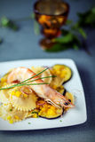 Seafood starter with prawns, ravioli and aubergine Stock Images
