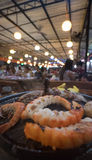 Seafood on steaming and grilling cooker pot Royalty Free Stock Images