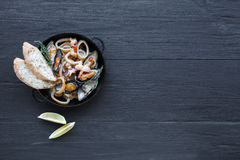 Seafood Stew on dark wood background, top view, copy space Stock Photography