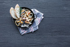 Seafood Stew on dark wood background, top view, copy space Royalty Free Stock Photo