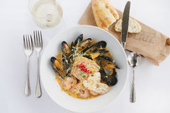 Seafood stew. Mussels and shrimp in a beautiful meal with white wine Royalty Free Stock Photos
