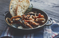 Seafood Stew in Saucepan, italian restaurant cuisine closeup Stock Photos