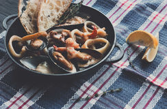 Seafood Stew in Saucepan, italian restaurant cuisine closeup Royalty Free Stock Photo