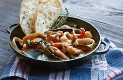 Seafood Stew in Saucepan, italian restaurant cuisine closeup Royalty Free Stock Photos