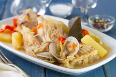 Seafood stew on white dish with wine Royalty Free Stock Photography