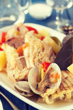 Seafood stew on white dish with wine Royalty Free Stock Photos