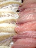 Seafood in the store. View at the fresh fish fillets on the ice in the store display case Stock Photo