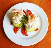 Seafood stuffed avocado. Exquisite seafood stuffed avocado with shrimp Royalty Free Stock Image